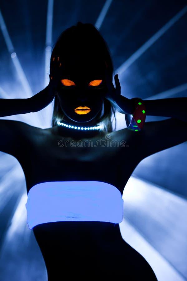 Flicka med den ultravioletta sminkdiskodansen arkivbild