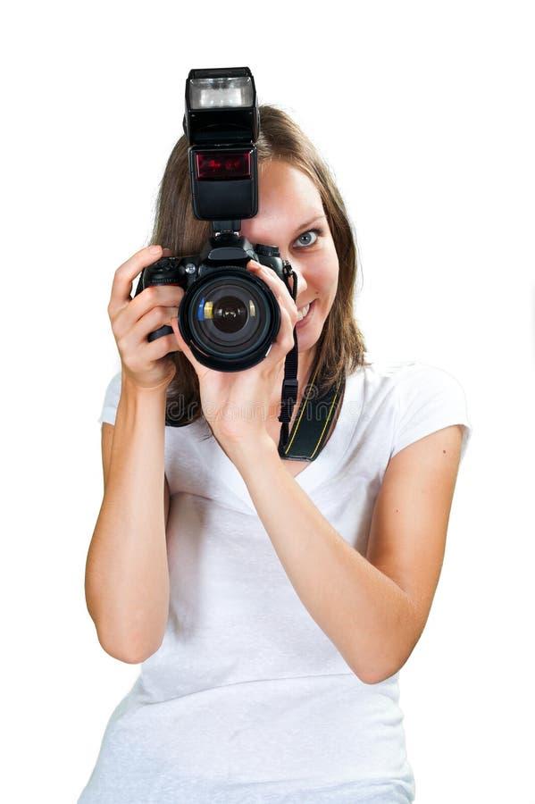 Flicka med den yrkesmässiga digitala kameran som isoleras på vit bakgrund arkivbilder