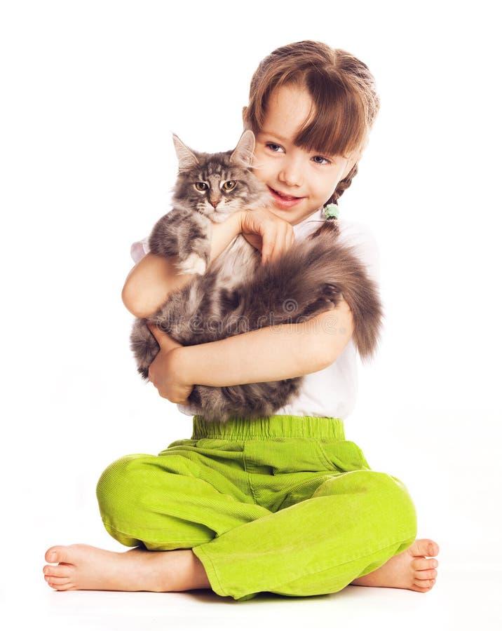 Flicka med en katt royaltyfria bilder