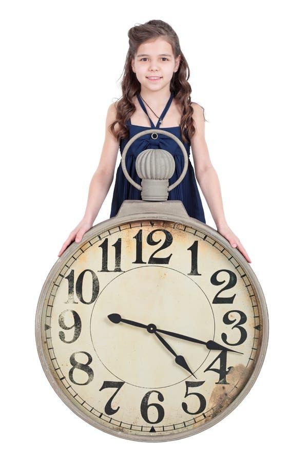 Flicka med en klocka royaltyfri bild
