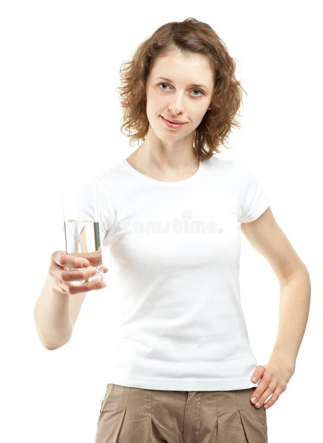 Flicka med ett exponeringsglas av dricksvatten royaltyfri bild