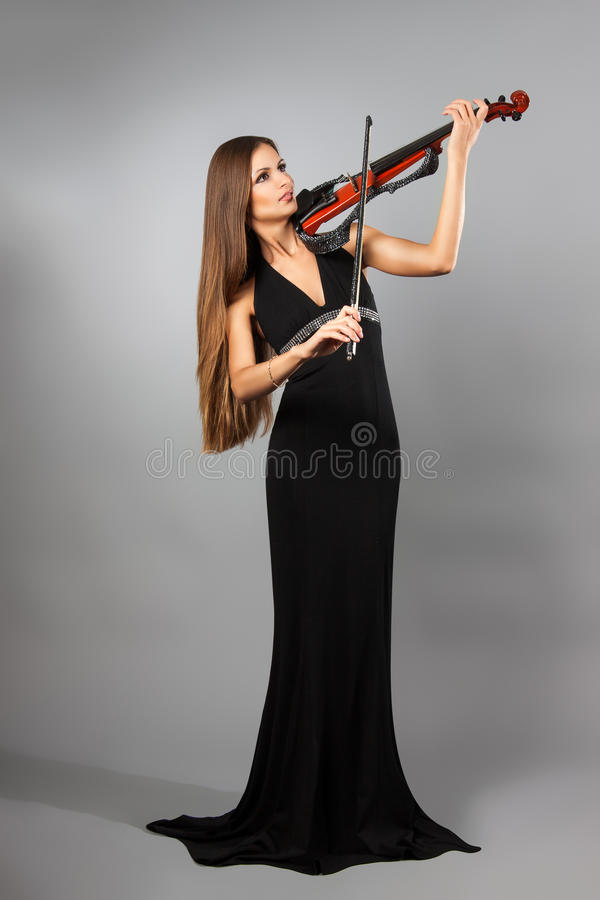 Flicka med fiolen arkivfoto