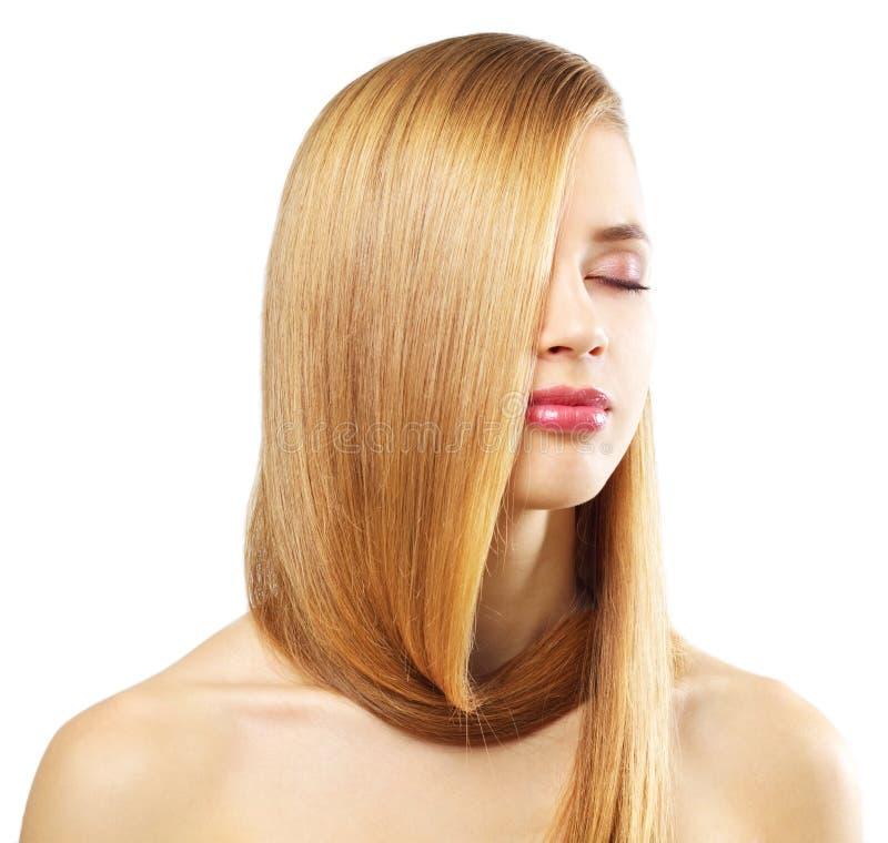 Flicka med härligt rakt hår på white royaltyfri fotografi