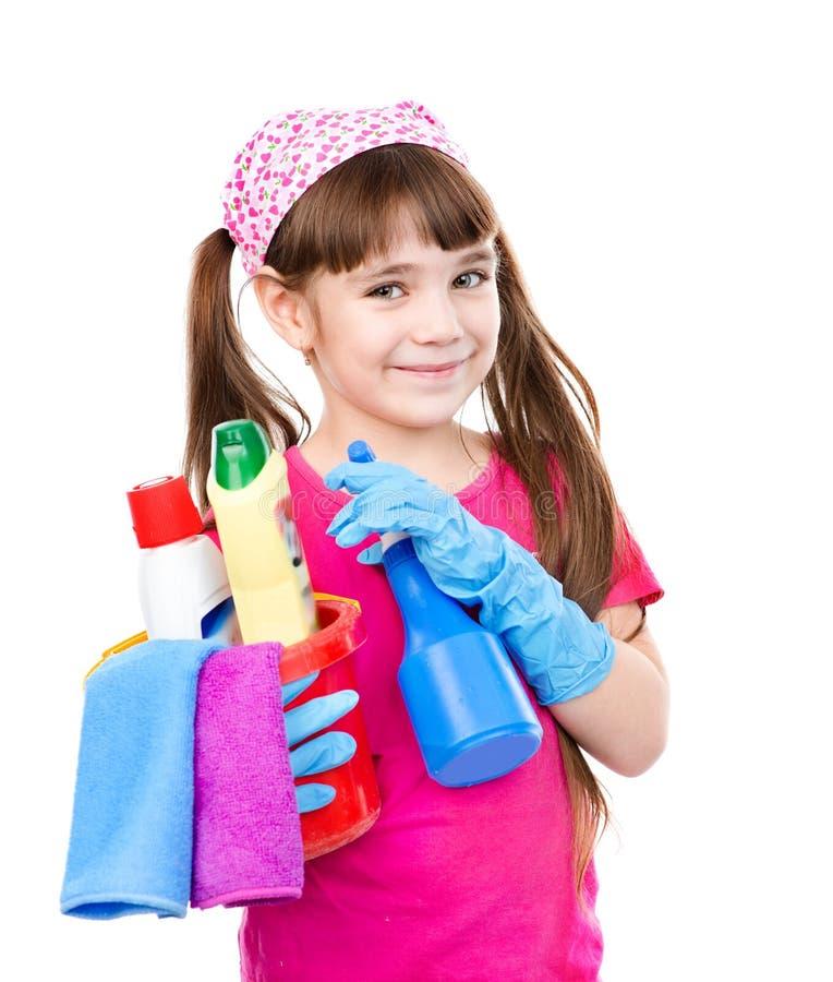 Flicka med hjälpmedel för huslokalvård på vit bakgrund royaltyfria bilder