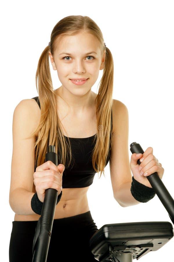 Flicka med idrottshallcykeln royaltyfria bilder