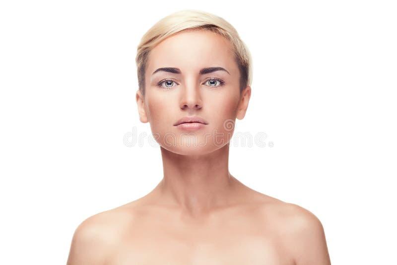 Flicka med inget smink på över vit bakgrund royaltyfri fotografi
