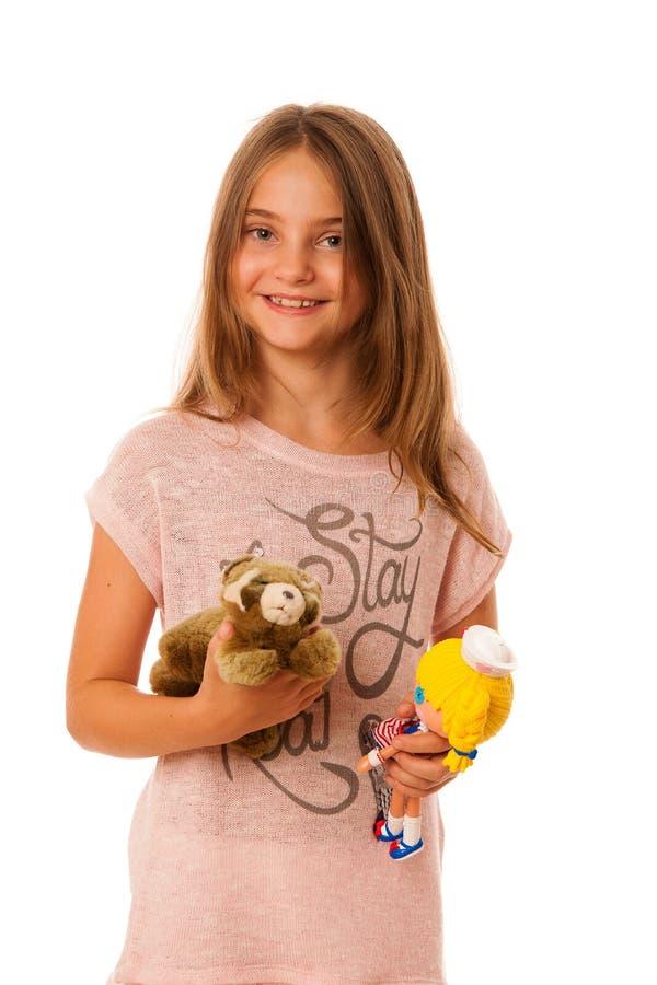 Flicka med leksaker som isoleras över vit bakgrund royaltyfria bilder