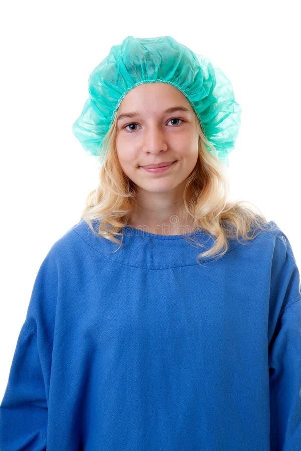 Flicka med operationkläder royaltyfria bilder