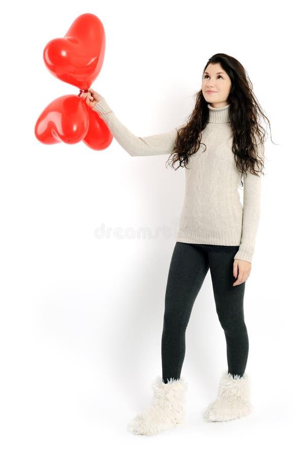 Flicka med röda ballonger arkivfoto