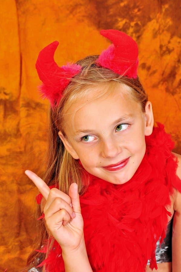 Flicka med röda horns royaltyfria bilder