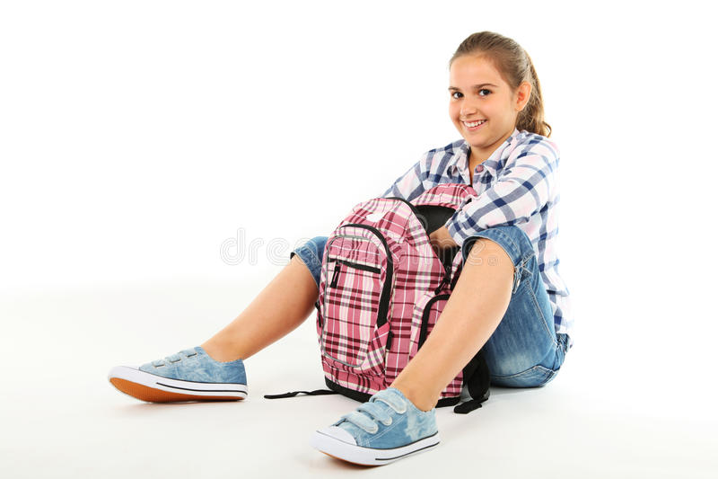 Flicka med ryggsäck royaltyfri bild