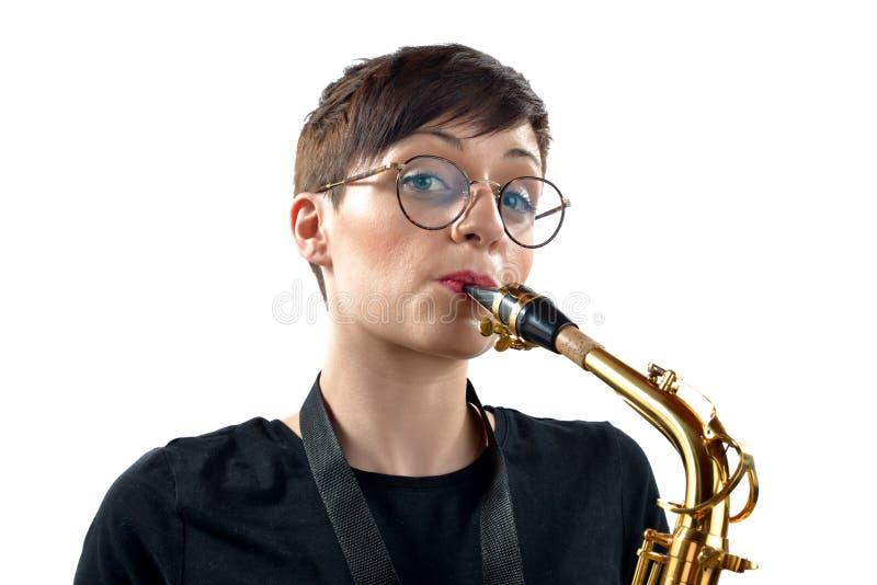 Flicka med saxofonen arkivfoton