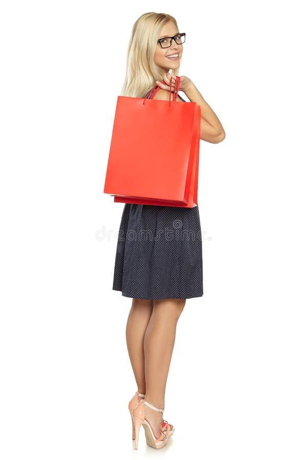 Flicka med shoppingpåsen royaltyfri fotografi