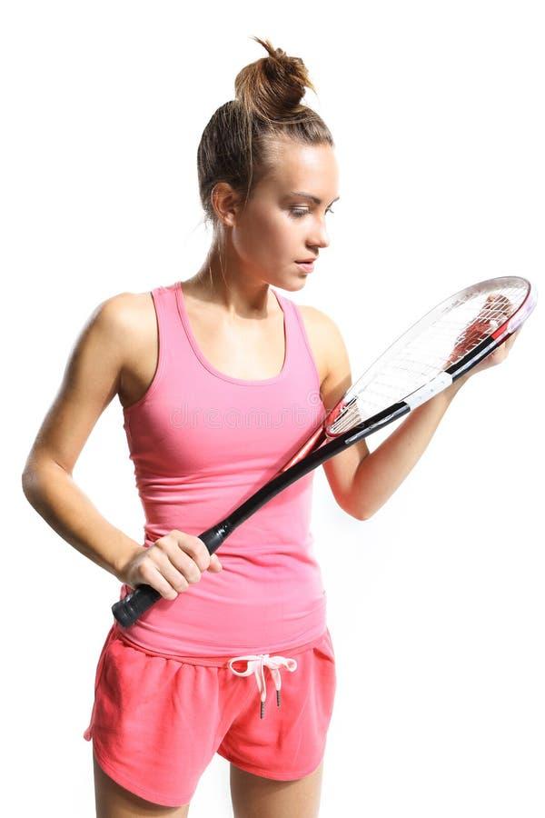 Flicka med squashracket fotografering för bildbyråer
