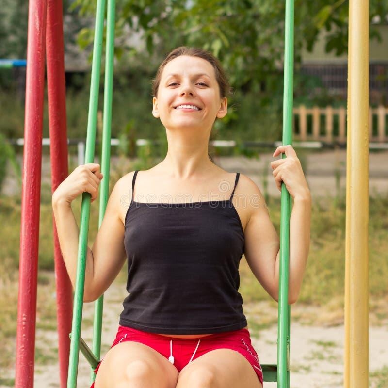 Flicka på en swing royaltyfri fotografi