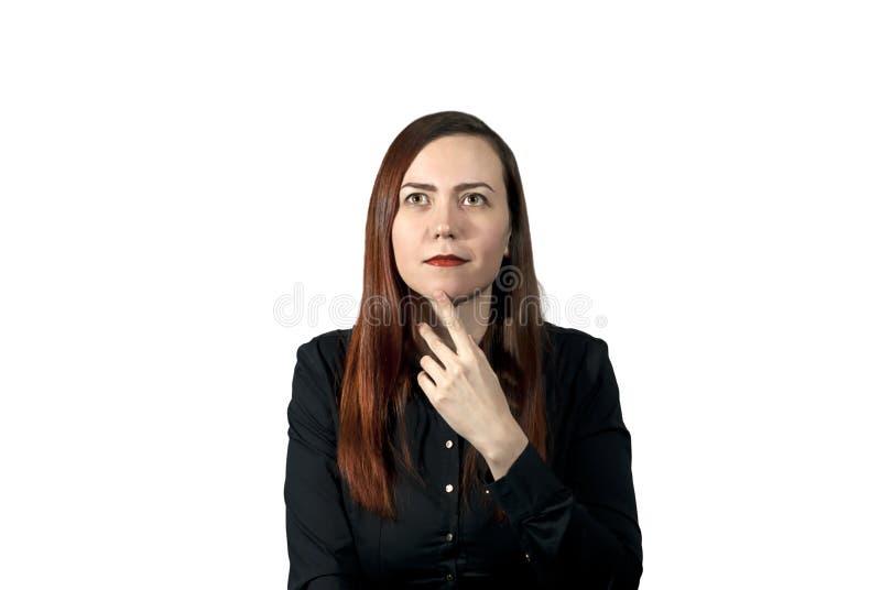 Flicka på vit bakgrund som hänsynsfullt ser upp royaltyfri fotografi