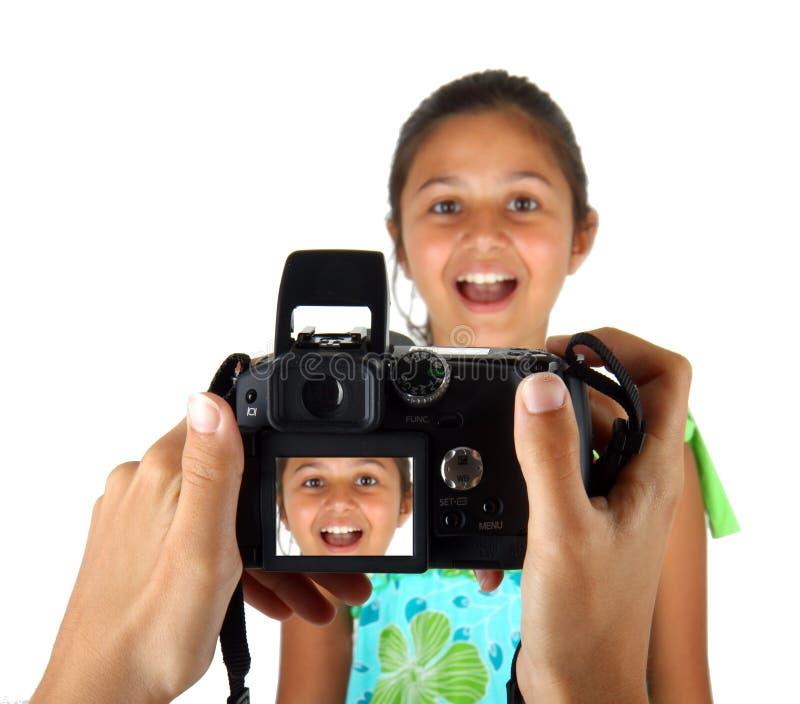 Flicka som fotograferas och visas på skärmen royaltyfri foto