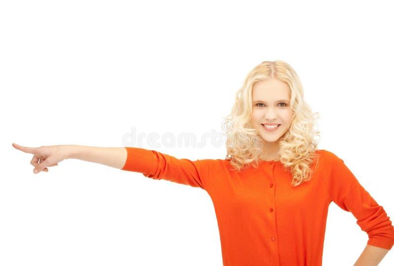 Flicka som från sidan pekar hennes finger fotografering för bildbyråer