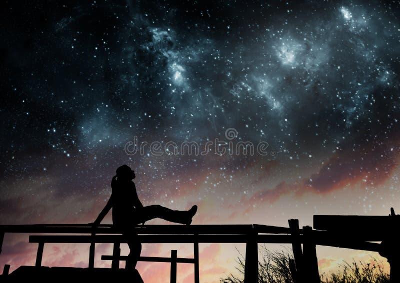 Flicka som håller ögonen på stjärnorna fotografering för bildbyråer