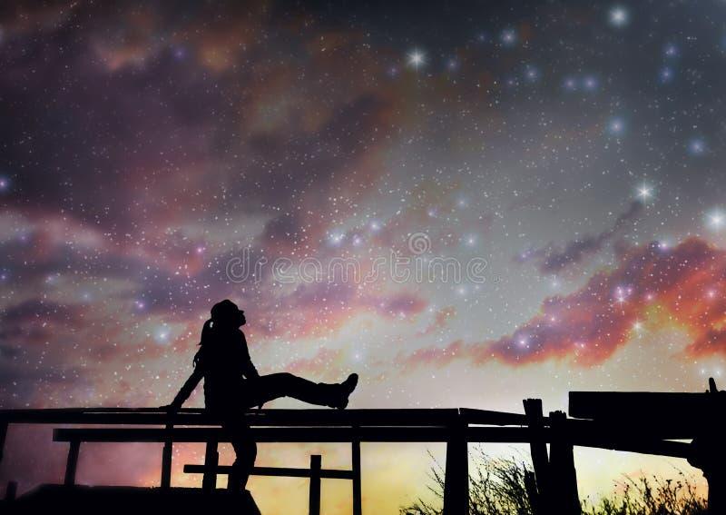 Flicka som håller ögonen på stjärnorna arkivbilder