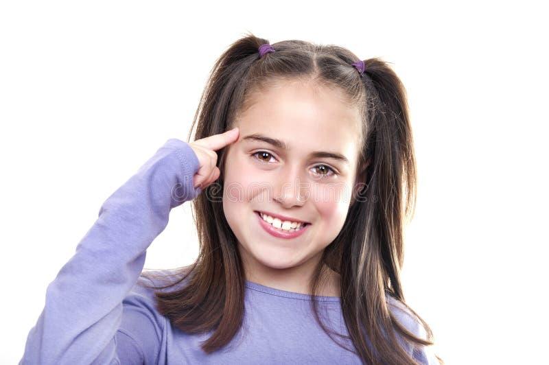 Flicka som har en djup tanke eller idé. arkivfoton