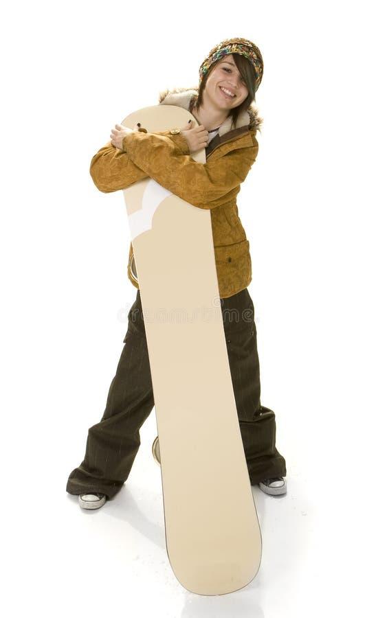 flicka som kramar den tonårs- snowboarden royaltyfria bilder