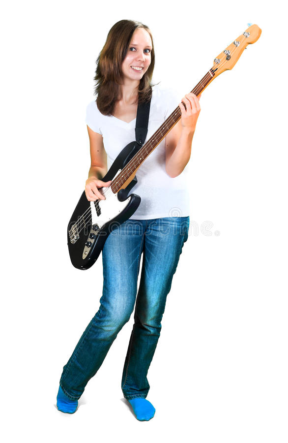 Flicka som spelar elbasen som isoleras på vit arkivfoton