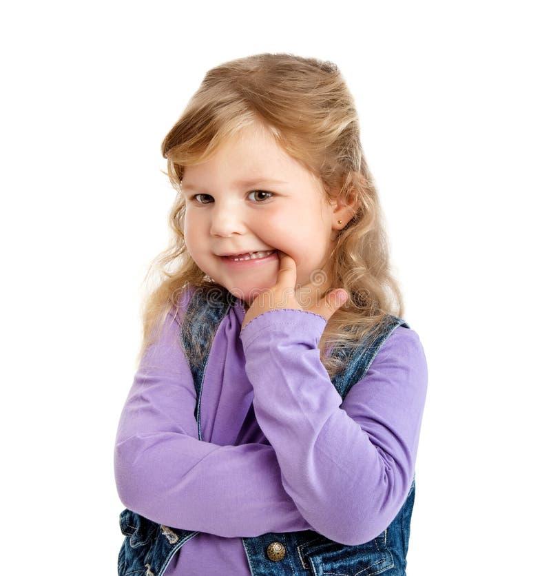 Flicka som visar hennes tänder royaltyfria bilder