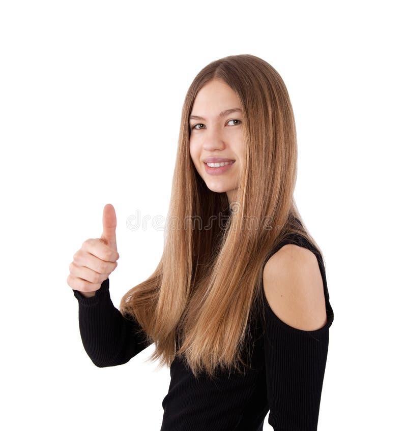 flicka som visar upp tumen arkivfoto