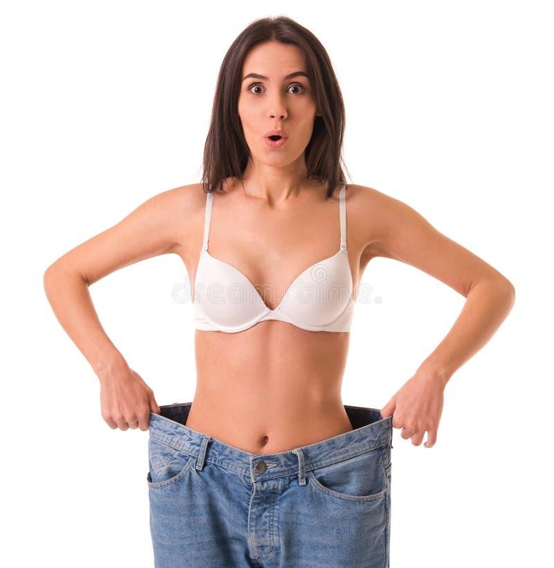 Flicka som visar viktförlust arkivbild