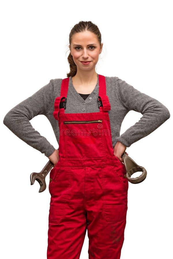 Flickaarbetare med skiftnyckeln arkivfoto