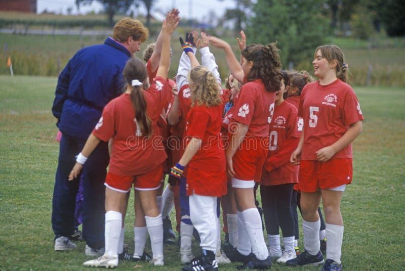 Flickafotbolllag fotografering för bildbyråer