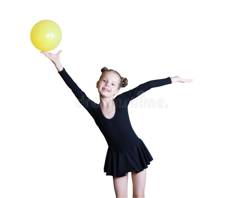 Flickagymnast med en boll arkivfoto