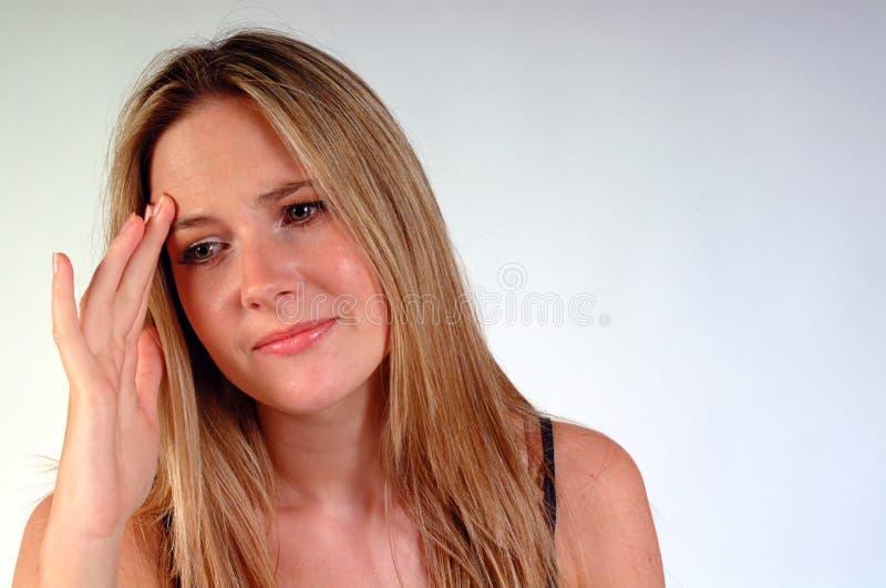 flickahuvudvärk arkivfoto