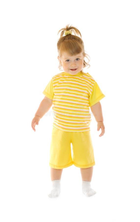 flickan flåsar liten le yellow för skjorta fotografering för bildbyråer