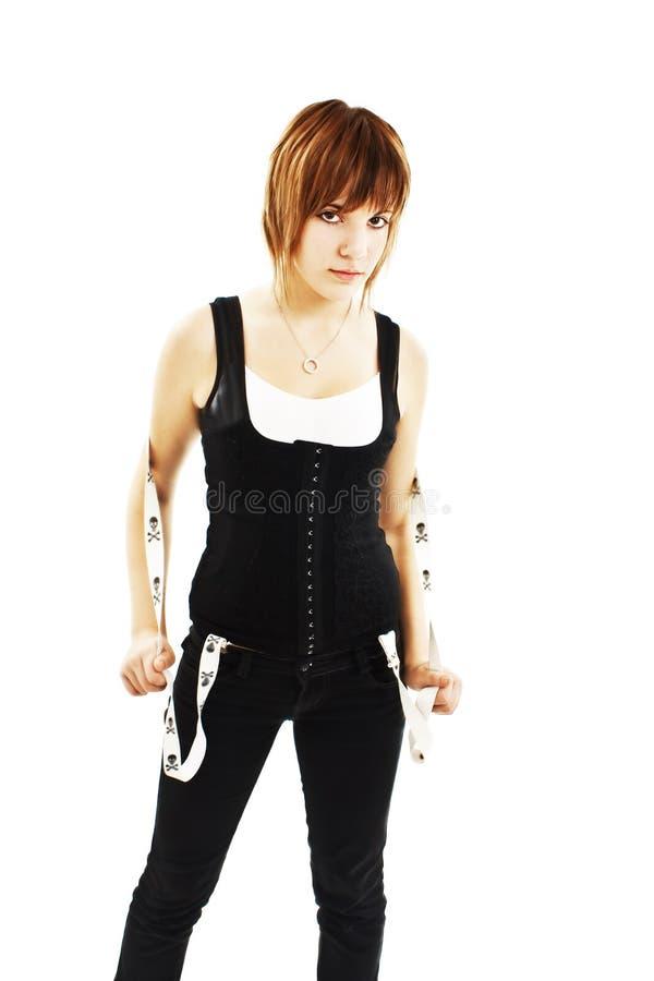 flickan flåsar punk suspendersslitage arkivfoto