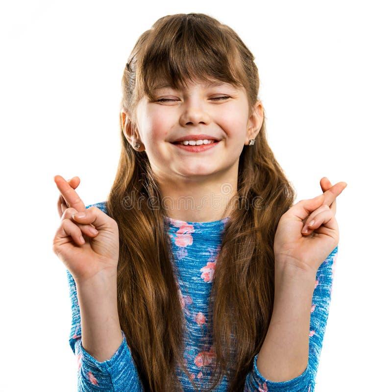 Flickan gör en önska Barndomdrömmar royaltyfri bild