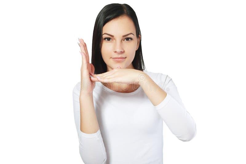 Flickan gör en gest automatisk frånslagningstid royaltyfri bild