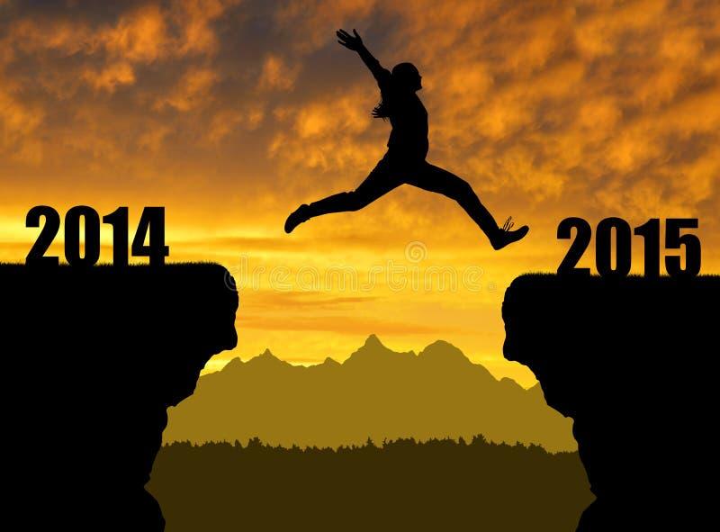 Flickan hoppar till det nya året 2015 arkivfoto