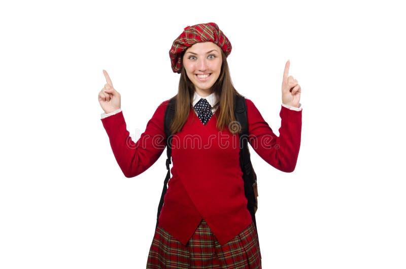 Flickan i skotska tartankläder på vit arkivfoton