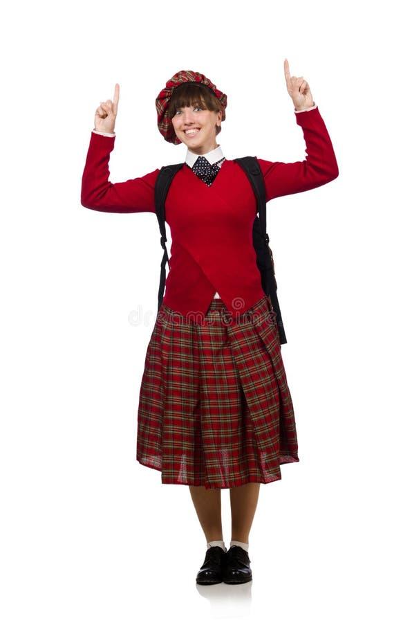 Flickan i skotska tartankläder som isoleras på vit royaltyfria bilder