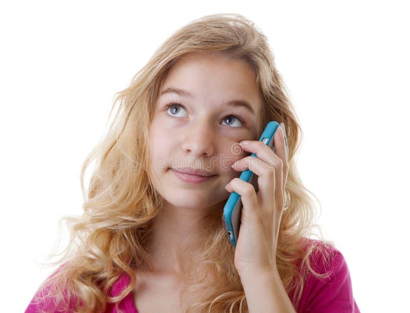 Flickan kallar på loking för mobiltelefon ledset royaltyfri foto