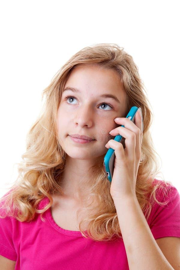 Flickan kallar på mobiltelefonen fotografering för bildbyråer