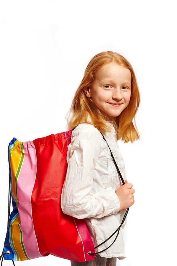 Flickan med shopping hänger lös fotografering för bildbyråer