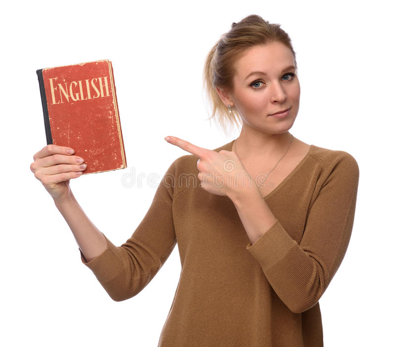 Flickan rymmer en engelsk ordbokbok fotografering för bildbyråer