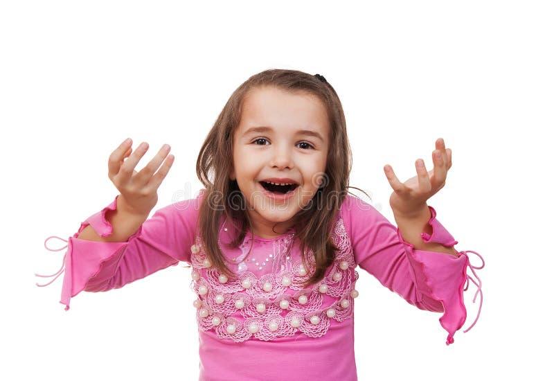Flickan visar det som mycket är förvånad royaltyfria foton