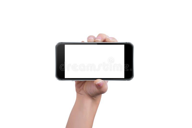 Flickan visar telefonen i en hand arkivbilder