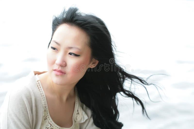 flickaorient eftertänksam wind royaltyfria foton