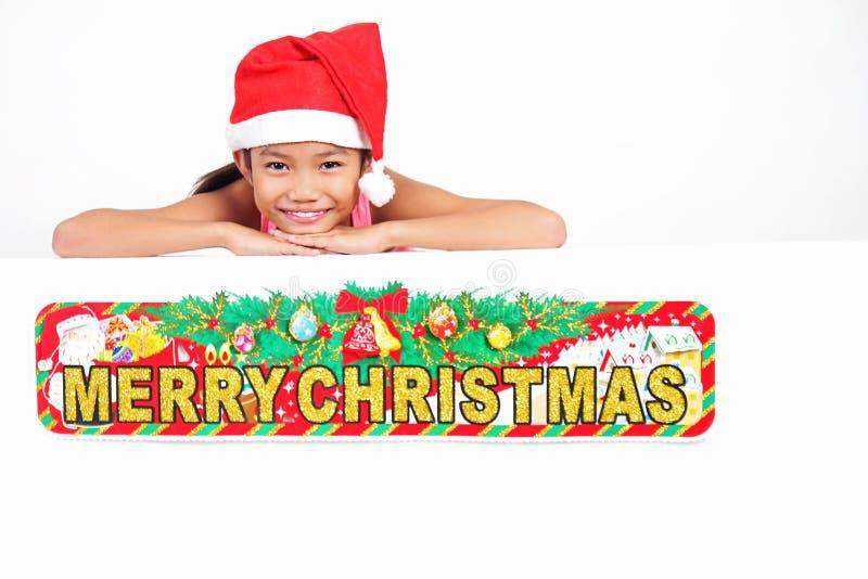 Flickas julhälsningar royaltyfri bild