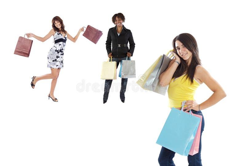 flickor som shoppar tre royaltyfri foto